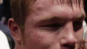 """Saul """"Canelo"""" Alvarez, of Mexico, smiles after beating Kermit Cintron, from Puerto Rico, during a WBC light middleweight championship boxing bout in Mexico City, Saturday, Nov. 26, 2011.(AP Photo/Dario Lopez-Mills)"""
