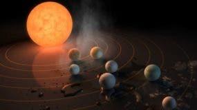 La estrella alrededor de la cual orbitan los siete planetas tiene una luz 2.000 veces más tenue que la de nuestro Sol.