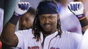 Boston Red Sox's Hanley Ramirez raises his arms as he celebrates in the dugout after his solo home run during the fifth inning of a baseball game against the Tampa Bay Rays at Fenway Park, Tuesday, Aug. 30, 2016, in Boston. (AP Photo/Charles Krupa)