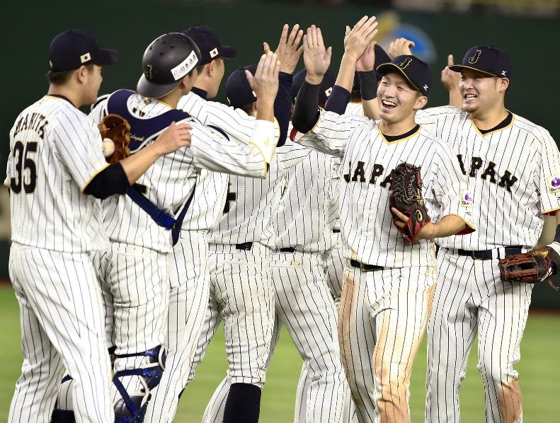 Japan's closer Kazuhisa Makita, left, celebrates with teammates after beating Israel 8-3 in their second round game at the World Baseball Classic at Tokyo Dome in Tokyo, Wednesday, March 15, 2017. Japan advanced to the championship round of the WBC. (AP Photo/Shizuo Kambayashi)