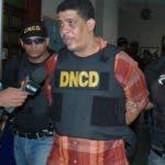 El alijo de  1,387.28 kilos de cocaína ocupados en  2004 a  la red de Quirino era custodiado por el coronel de la PN Lidio Nin Terrero.