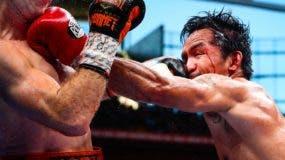 Manny Pacquiao conecta una izquierda al rostro de  Jeff Horn durante el combate.