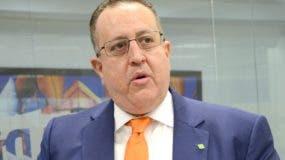 Magín Díaz, director de     Impuestos Internos.