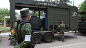 Los soldados mexicanos del 11º Batallón de Infantería comienzan su despliegue hacia el sur de Yucatán en el marco del plan de emergencia DN-III en previsión de la llegada de la tormenta tropical Franklin, en Mérida, Yucatán, México. AFP