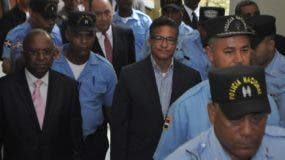 Pedro Rafael Peña Antonio acompañado de abogados durante una de las audiencias por el caso.