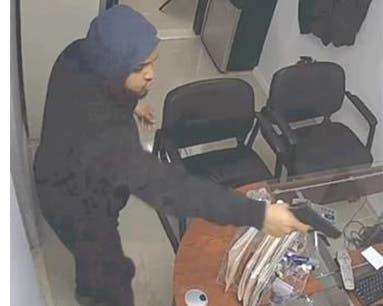 Imagen del asalto captada por una cámara de seguridad del negocio.