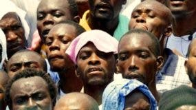 """A crowd listens via speakers to Haiti's presidential inauguration ceremony, outside the Haitian National Palace in Port-au-Prince, Haiti, Saturday May 14,  2011. The 50-year-old performer, Michel Martelly,  known to Haitians as """"Sweet Micky"""" was swept to power in a March 20 presidential runoff by Haitians tired of past leaders who failed to provide even basic services, such as decent roads, water and electricity in the Western Hemisphere's poorest country.  (AP Photo/Ramon Espinosa)"""