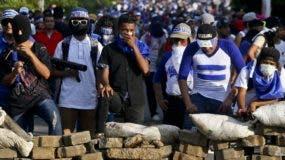 Los manifestantes piden la renuncia del presidente Ortega.  AP