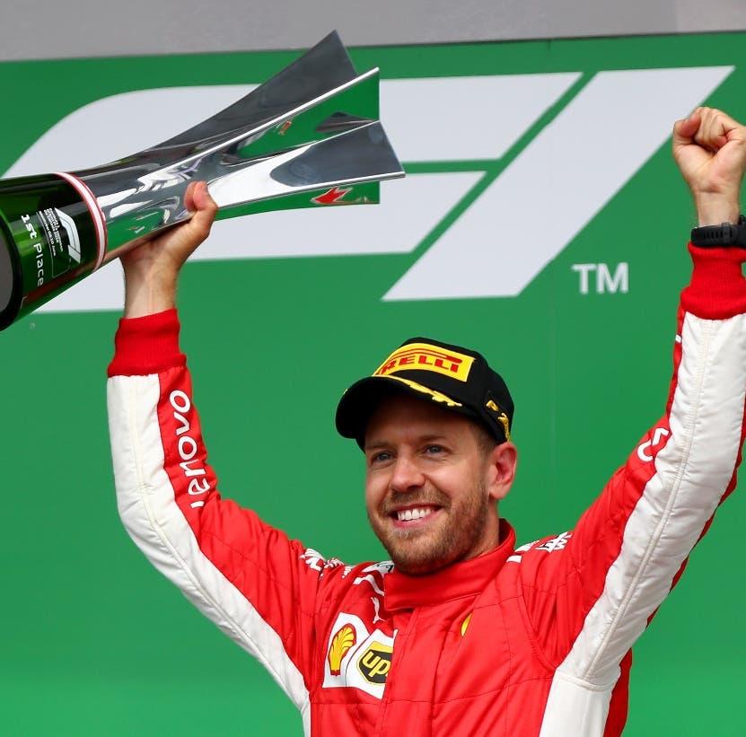 Vettel celebra la victoria  para tomar el liderazgo de la F-1.