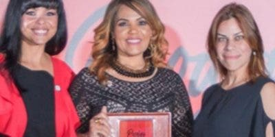 Dianny Peña, Carmen Minaya, Aileen Mella. Durante la celebración del 20 aniversario.