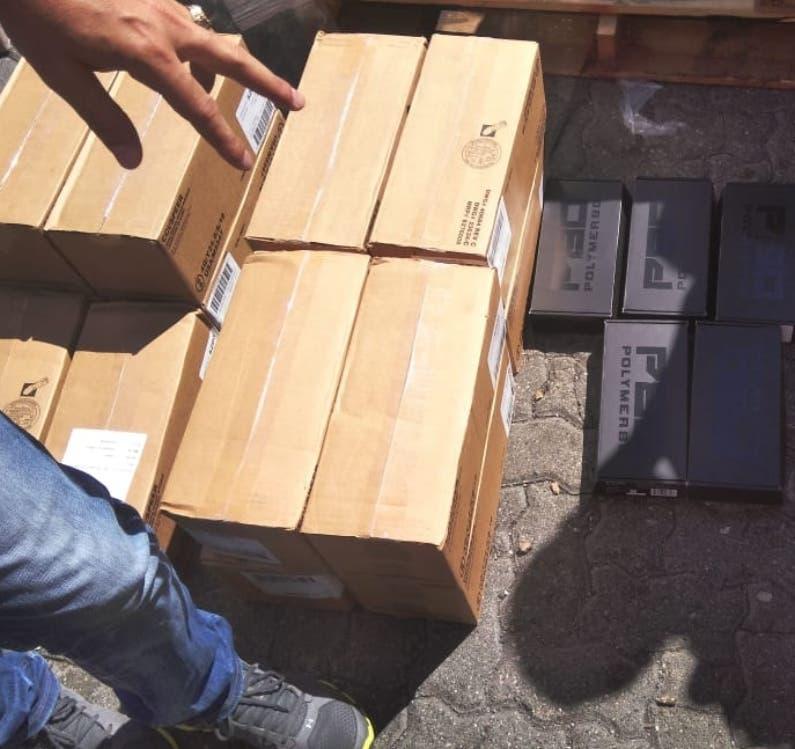 Cajas de armas y municiones decomisadas en Haina.  Archivo