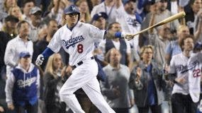 Los Angeles Dodgers' Manny Machado watches his single against the Boston Red Sox during the sixth inning in Game 3 of the World Series baseball game on Friday, Oct. 26, 2018, in Los Angeles. (AP Photo/Mark J. Terrill)