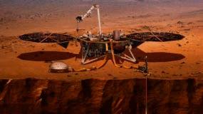 Una ilustración suministrada por la NASA de cómo se vería la sonda InSight en Marte. (NASA via AP)