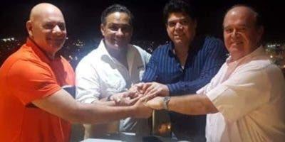 Mandy González, Georgie Herrera, Marcos Pichardo y Biagio Parisi, durante  el encuentro para la  alianza estratégica.