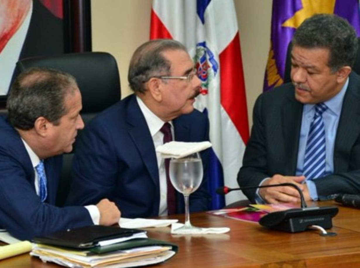 Reinaldo Pared Pérez, el presidente Danilo Medina y el expresidente Leonel Fernández.  Archivo
