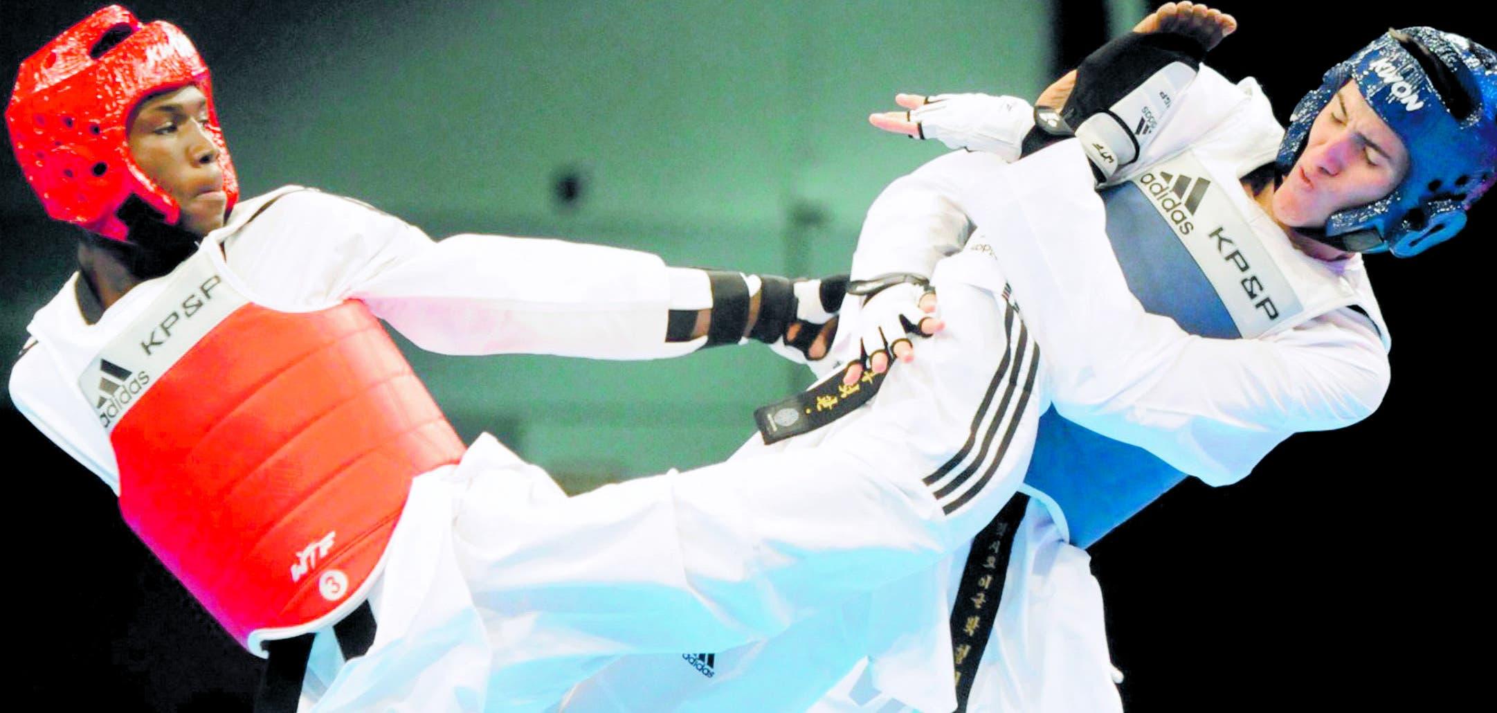 Bernardo Pie, izquierda, en plena acción en una de sus grandes competencias. Se prepara para una medalla en Lima.