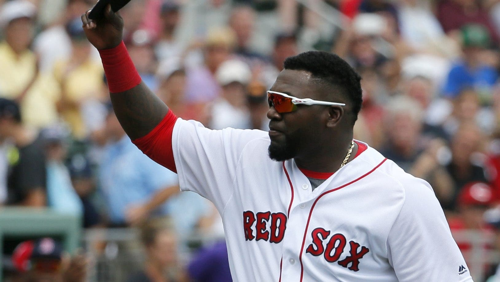 Boston Red Sox's David Ortiz acknowledges cheers from fans after being introduced during a ceremony honoring him before a spring training baseball game against the Baltimore Orioles, Monday, March 28, 2016, in Fort Myers, Fla. Ortiz played his last spring training home game at jetBlue Park Monday. (AP Photo/Tony Gutierrez)