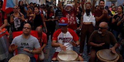 Manifestantes durante una marcha exigiendo la renuncia de Rosselló el pasado 18 de julio.