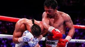 Manny Pacquiao de las Filipinas (R) en acción contra Keith Thurman de los EE. UU. Por su pelea por el título del Campeonato Mundial de Peso súper welter de la AMB en MGM Grand Garden Arena en Las Vegas, Nevada, EE. UU., 20 de julio de 2019. EFE