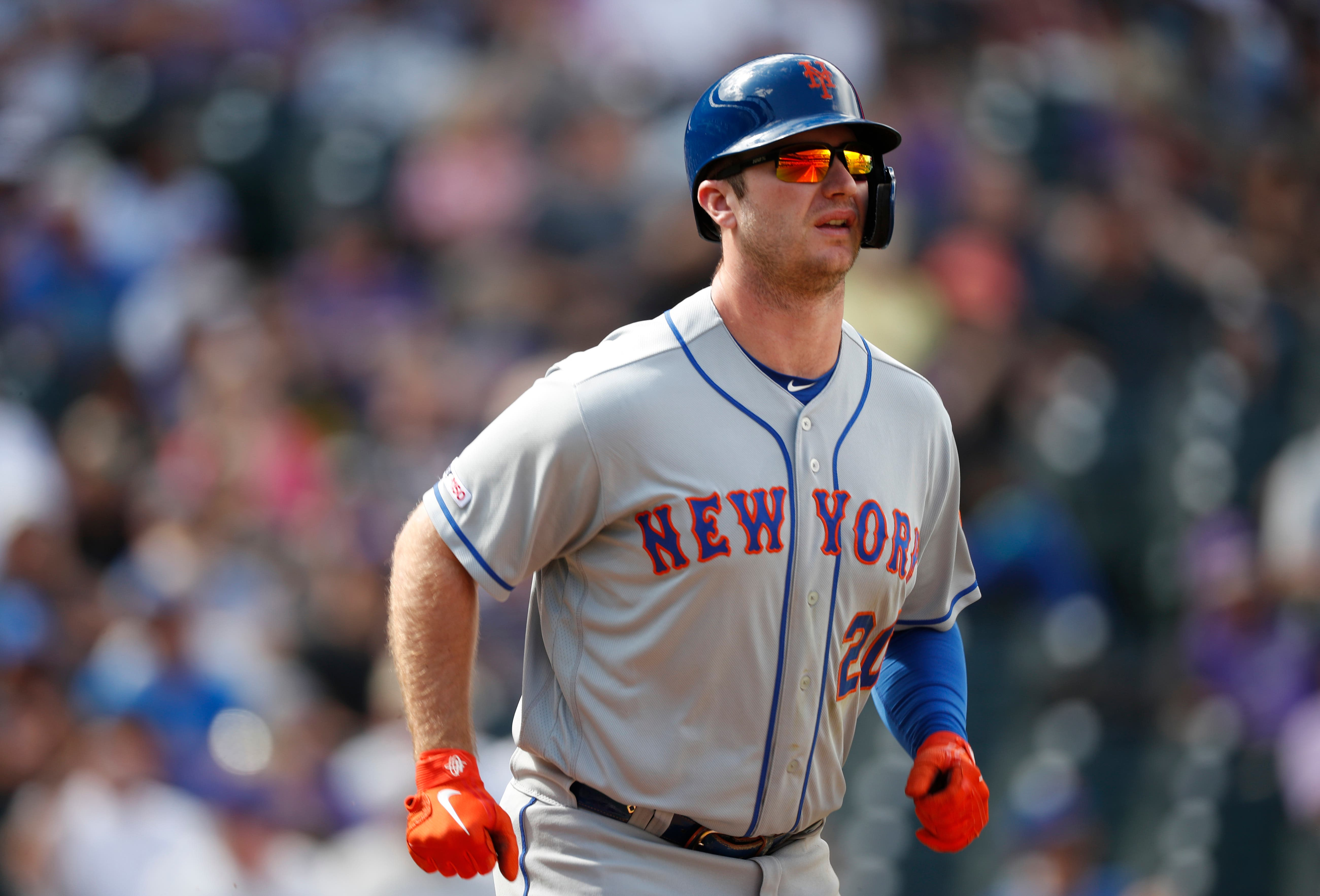 New York Mets' Pete Alonso heads to first base after being hit by Colorado Rockies starting pitcher Jeff Hoffman in the third inning of a baseball game Wednesday, Sept. 18, 2019, in Denver. (AP Photo/David Zalubowski)