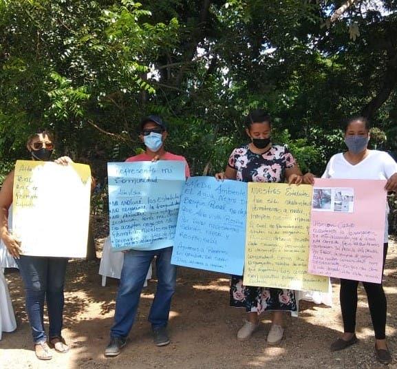 Residentes del kilómetro 14 de la Autopista Duarte exigen detener invasiones