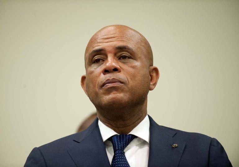 Grupos de izquierda declaran Martelly persona no grata en el país